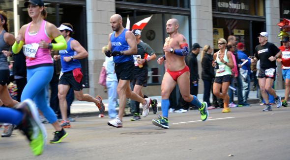 Also, this dude, who I saw early, and then I passed at mile 26.  If you're wearing a speedo, don't walk.